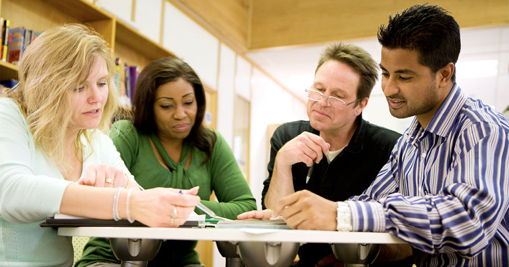Photo of teachers studying materials