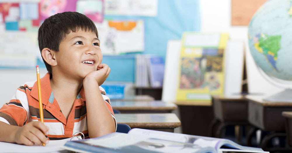 Image of child smiling while learning